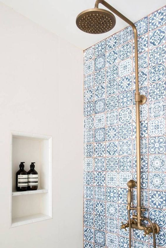 blue and white tile shower